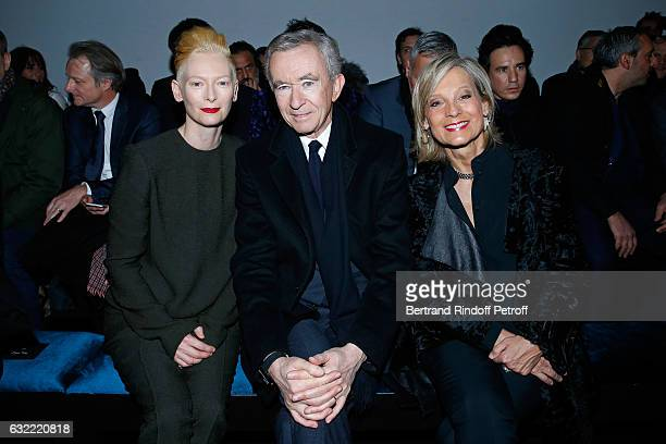 Tilda Swinton Owner of LVMH Luxury Group Bernard Arnault and his wife Helene Arnault attend the Berluti Menswear Fall/Winter 20172018 show as part of...