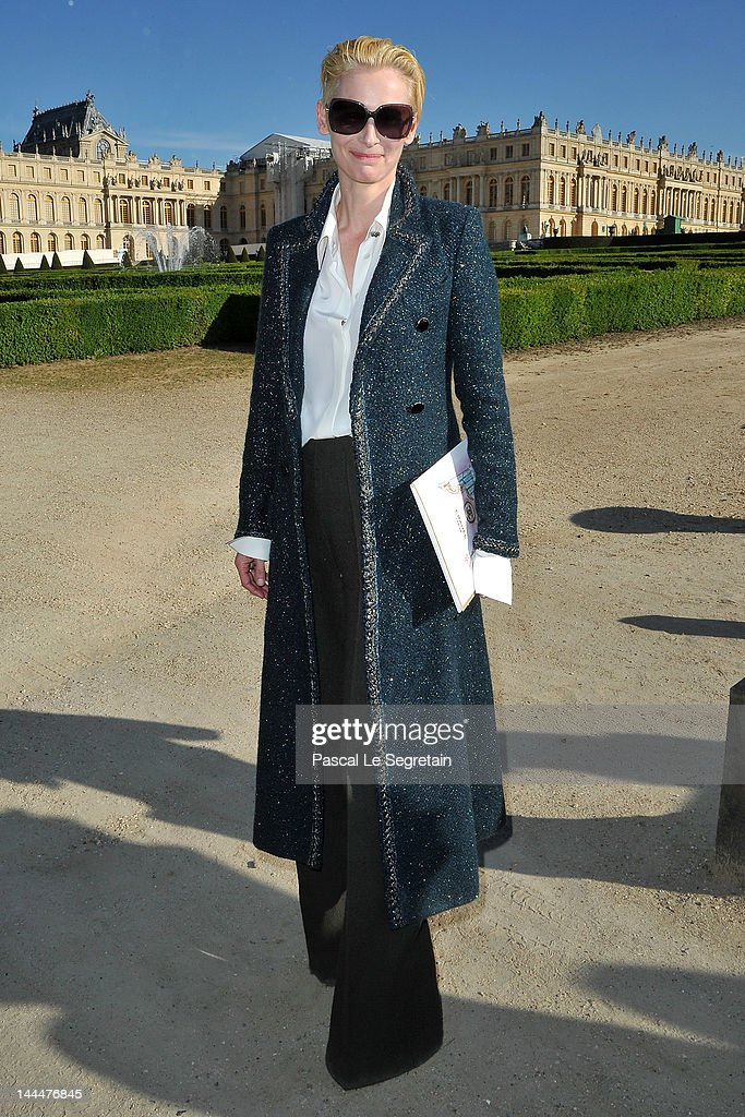 <a gi-track='captionPersonalityLinkClicked' href=/galleries/search?phrase=Tilda+Swinton&family=editorial&specificpeople=202991 ng-click='$event.stopPropagation()'>Tilda Swinton</a> poses during the Chanel 2012/13 Cruise Collection at Chateau de Versailles on May 14, 2012 in Versailles, France.