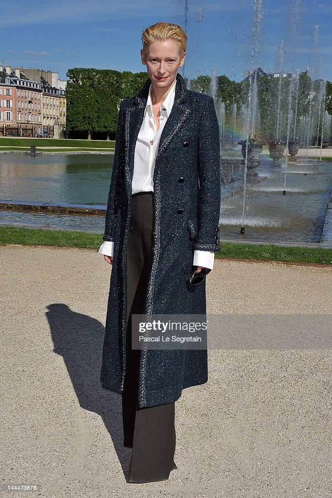 Tilda Swinton poses during the Chanel 2012/13 Cruise Collection Photocall at Chateau de Versailles on May 14 2012 in Versailles France