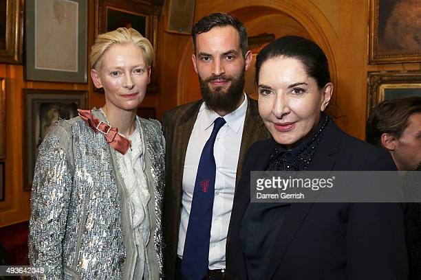 Tilda Swinton Sandro Kopp and Marina Abramovic attend 'A Bigger Splash' premiere after party presented by AnOther x Dior at Annabel's on October 21...