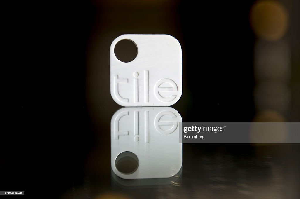 A Tile Bluetooth device is reflected on a table after a Bloomberg West Television interview with Nick Evans, co-founder of Reveal Labs and chief executive officer of Tile, unseen, in San Francisco, California, U.S., on Friday, Aug. 16, 2013. Tiles are Bluetooth tags that help find lost items on which the device is attached. Photographer: David Paul Morris/Bloomberg via Getty Images