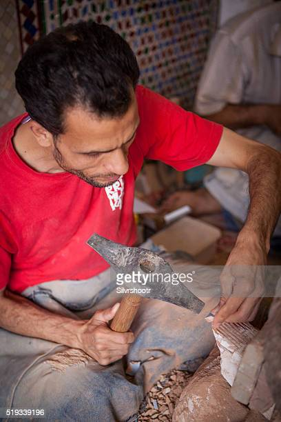 Tile cutter working at Tamegroute Pottery Co-op near Fez.