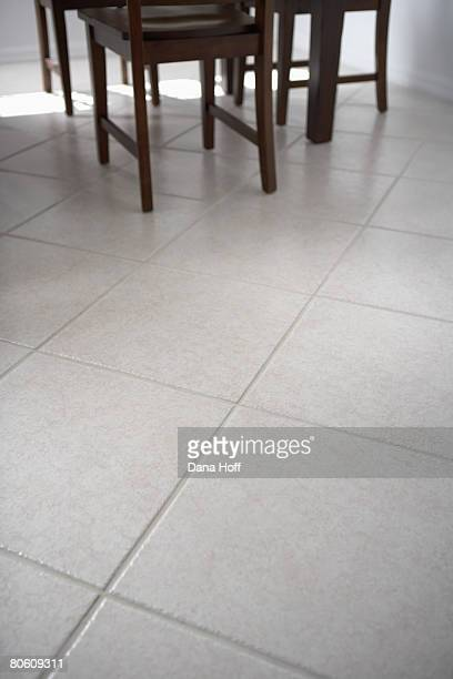 Tile floor and dining furniture