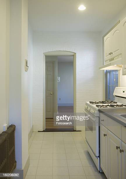 Tile floor in small apartment kitchen