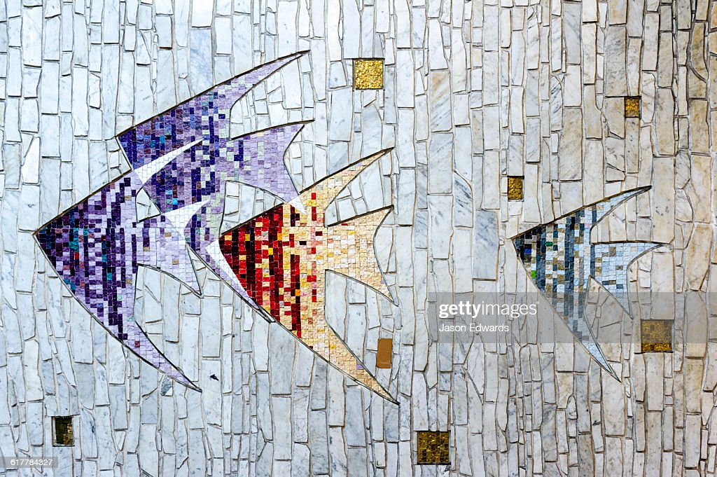 A tile mosaic of Angel Fish on a railway subway wall.