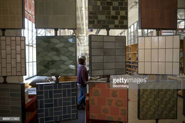 Tile samples hang on display inside the showroom at the Heath Ceramics Ltd production facility in San Francisco California US on Friday June 2 2017...