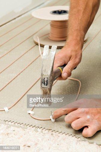 Electric Floor Heat In Bathroom : Tile setter installing electric radiant floor heat in a