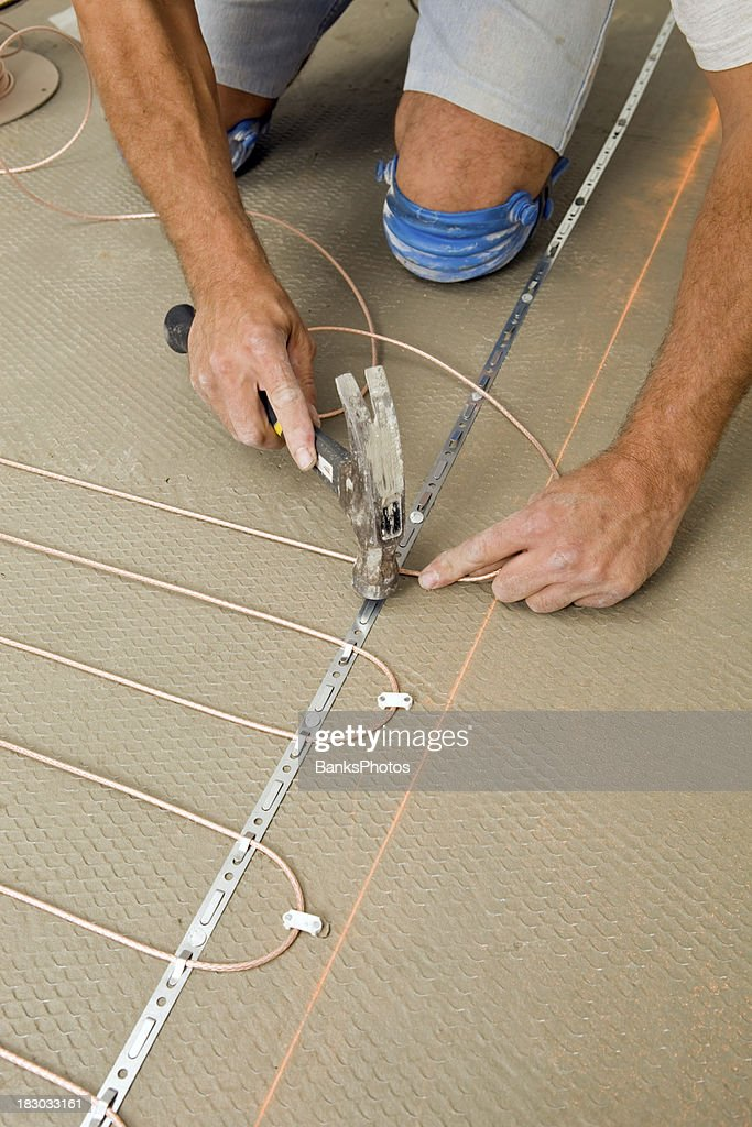 Tile Setter Installing Electric Radiant Floor Heat In A Bathroom Stock Photo Getty Images