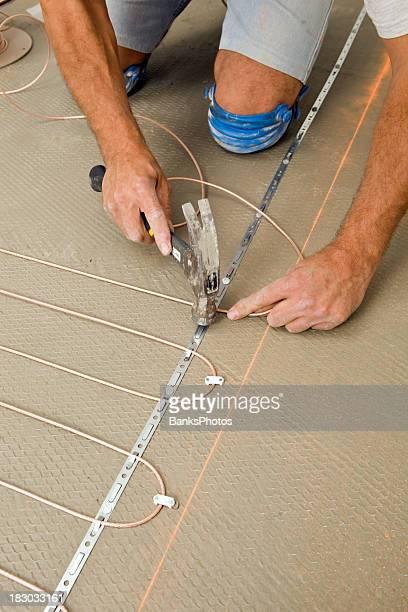 Tile Setter Installing Electric Radiant Floor Heat in a Bathroom