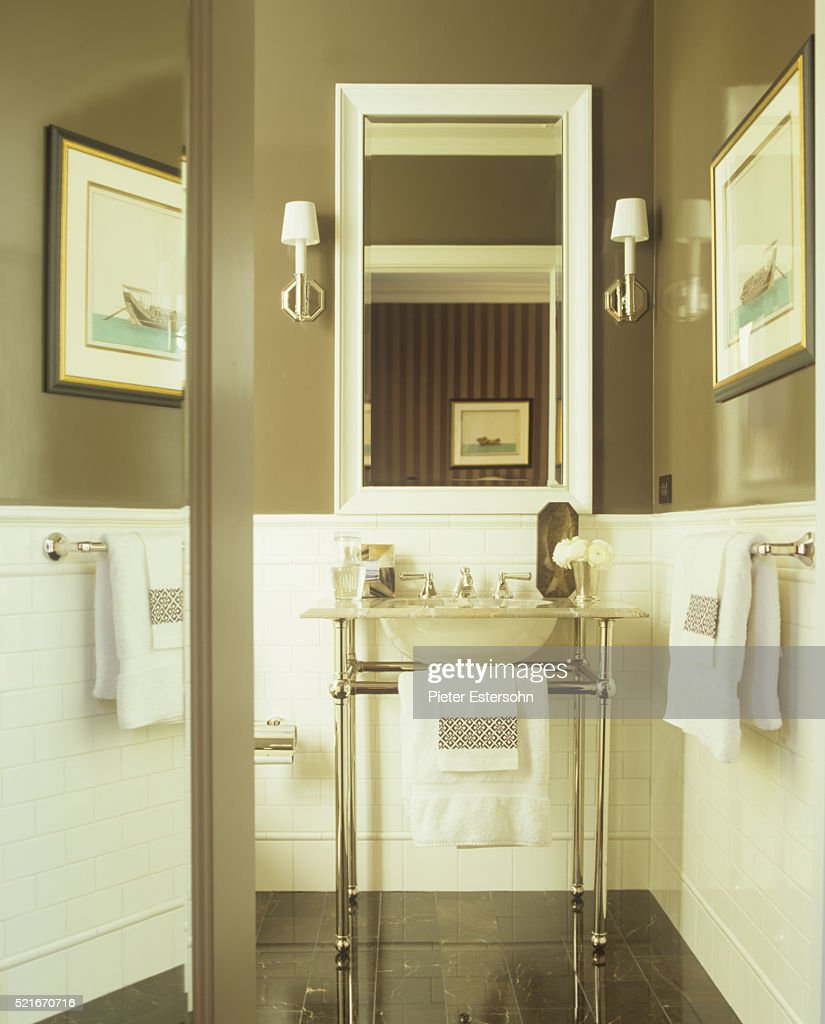 Tile Wainscoting And Console Sink In Bathroom Stock Photo | Getty ...