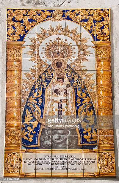Tiled plaque of the Blessed Virgin Mary, Maria Virgen de Regla, on a sandstone church in the center of the Andalusian town of Chipiona, Spain, Europe