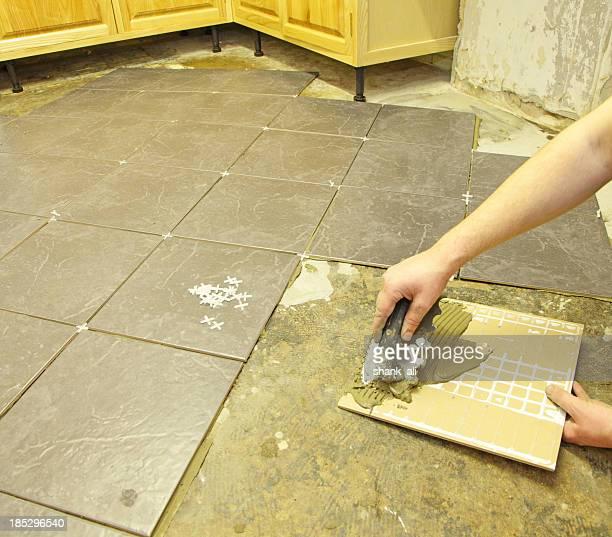 tiler working in a kitchen