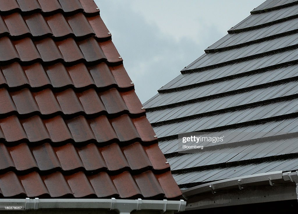 Tiles and platic guttering sit on the roofs of residential property in Newcastle-upon-Tyne, U.K., on Wednesday, Sept. 11, 2013. U.K. house prices rose for a seventh month in August and will probably continue to increase through the rest of the year, according to a report by Halifax. Photographer: Nigel Roddis/Bloomberg via Getty Images