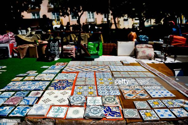Tiles are displayed for sale at 'Feira da Ladra' market in Lisbon on July 1 2017 They used to adorn everything from park benches to cathedrals but...
