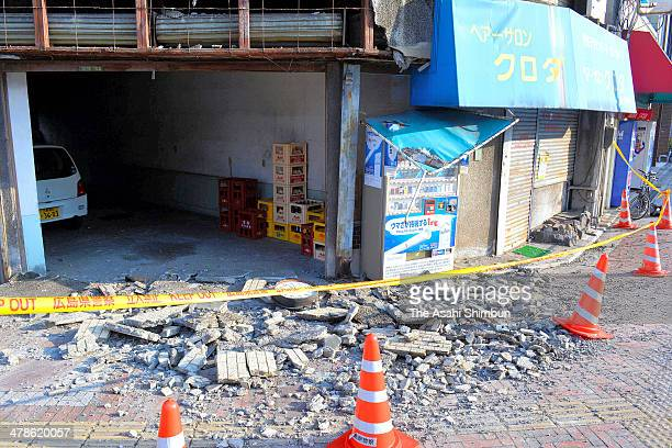 Tiles of a building are scattered after the magnitude 61 earthquake strcuk on March 14 2014 in Kure Hiroshima Japan