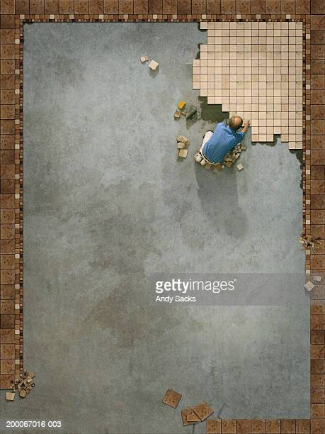 Tilesetter beginning large floor pattern, overhead view