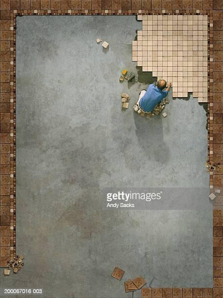 Tilesetter beginning large floor pattern, overhead view