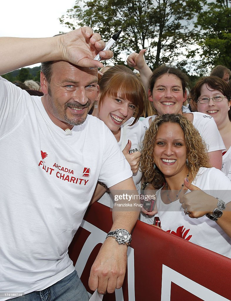 Till Demtroeder and fans attend the Charity Event Benefitting Flood Victims on July 20, 2013 in Grafenau, Germany.