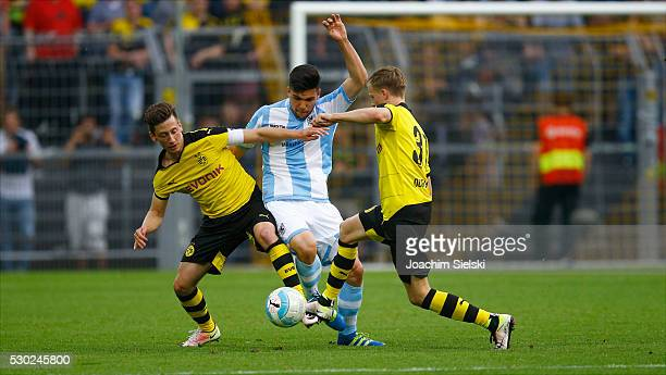 Till Schumacher and Dzenis Burnic of Dortmund challenges Julian Justvan of Muenchen during the German U19 Championship Semi Final First Leg match...