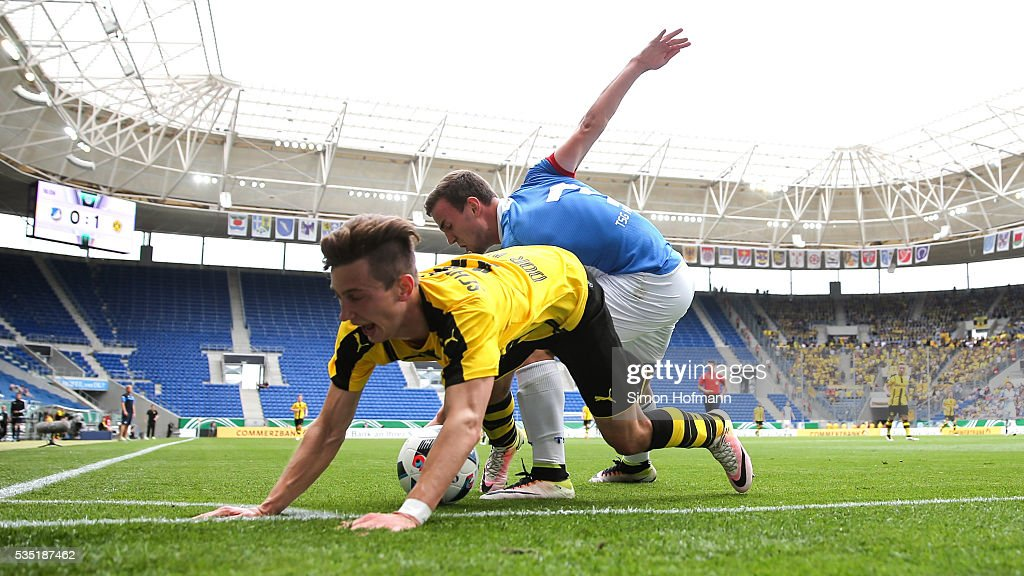 Till Schumacher of Dortmund is challenged by <a gi-track='captionPersonalityLinkClicked' href=/galleries/search?phrase=Benedikt+Gimber&family=editorial&specificpeople=9718811 ng-click='$event.stopPropagation()'>Benedikt Gimber</a> of Hoffenheim during the A Juniors German Championship Final match between 1899 Hoffenheim U19 and Borussia Dortmund U19 at Wirsol Rhein-Neckar-Arena on May 29, 2016 in Sinsheim, Germany.
