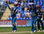 Tillakaratne Dilshan and Angelo Mathews of Sri Lanka appeal successfully for the wicket of James Franklin of New Zealand during the ICC Champions...