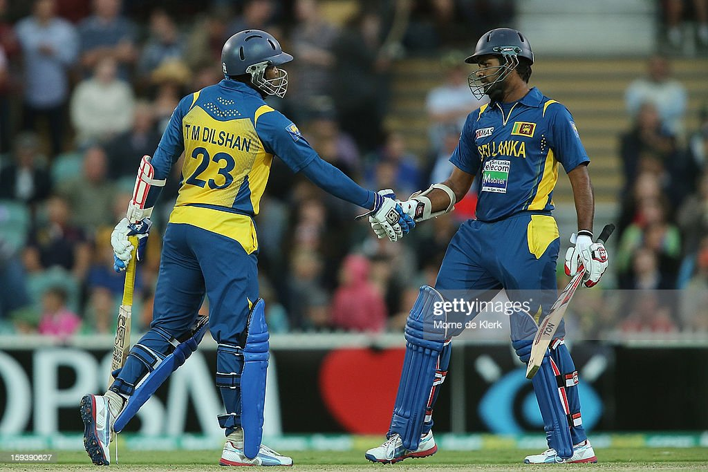 Tillakaratne Dilshan (L) congratulates team mate Lahiru Thirimanne of Sri Lanka after he reached 50 runs during game two of the Commonwealth Bank One Day International series between Australia and Sri Lanka at Adelaide Oval on January 13, 2013 in Adelaide, Australia.
