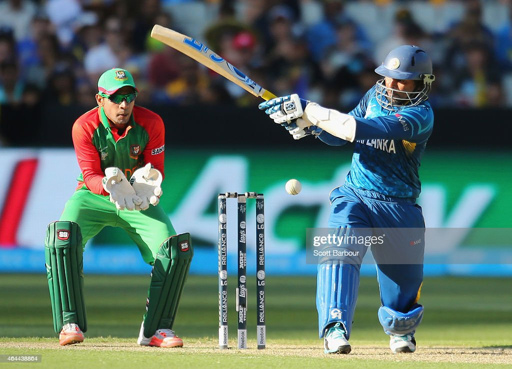 Tillakaratne Dilshan of Sri Lanka bats as wicketkeeper Mushfiqur Rahim of Bangladesh looks on during the 2015 ICC Cricket World Cup match between Sri Lanka and Bangladesh at Melbourne Cricket Ground on February 26, 2015 in Melbourne, Australia.