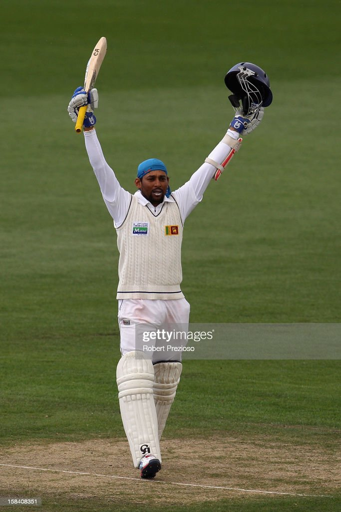 <a gi-track='captionPersonalityLinkClicked' href=/galleries/search?phrase=Tillakaratne+Dilshan&family=editorial&specificpeople=239186 ng-click='$event.stopPropagation()'>Tillakaratne Dilshan</a> of Sri Lanka celebrates after reaching his century during day three of the First Test match between Australia and Sri Lanka at Blundstone Arena on December 16, 2012 in Hobart, Australia.