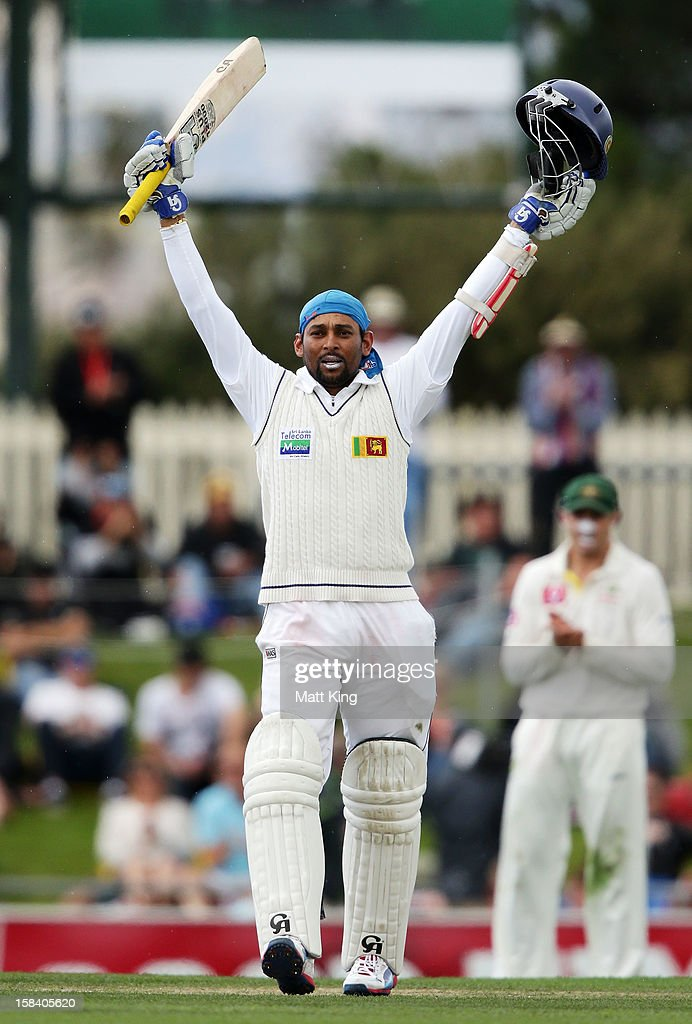 <a gi-track='captionPersonalityLinkClicked' href=/galleries/search?phrase=Tillakaratne+Dilshan&family=editorial&specificpeople=239186 ng-click='$event.stopPropagation()'>Tillakaratne Dilshan</a> of Sri Lanka celebrates scoring a century during day three of the First Test match between Australia and Sri Lanka at Blundstone Arena on December 16, 2012 in Hobart, Australia.