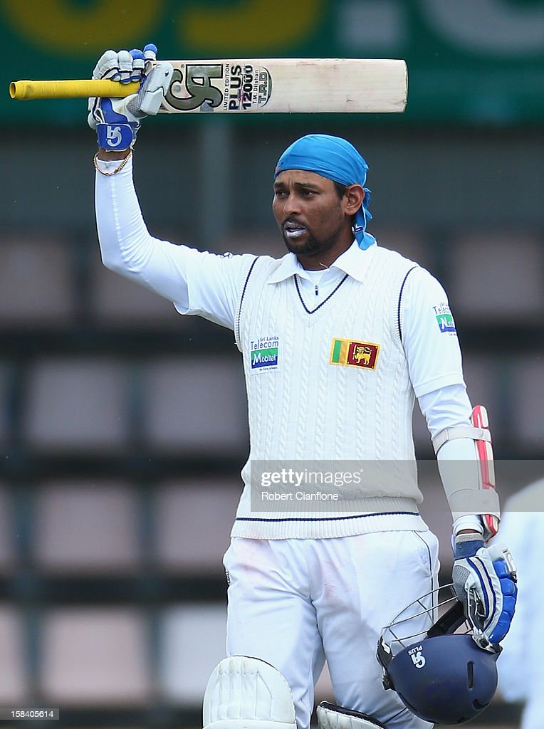 <a gi-track='captionPersonalityLinkClicked' href=/galleries/search?phrase=Tillakaratne+Dilshan&family=editorial&specificpeople=239186 ng-click='$event.stopPropagation()'>Tillakaratne Dilshan</a> of Sri Lanka celebrates scoring his century during day three of the First Test match between Australia and Sri Lanka at Blundstone Arena on December 16, 2012 in Hobart, Australia.