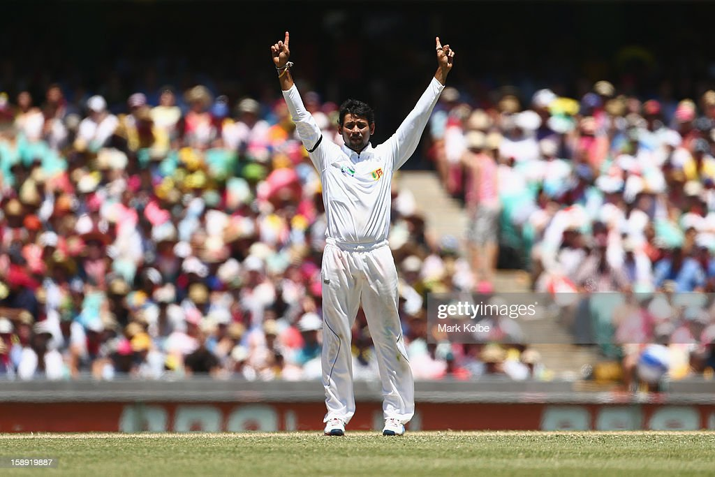 Tillakaratne Dilshan of Sri Lanka celebrates the wicket of David Warner of Australia tralia and Sri Lanka at Sydney Cricket Ground on January 4, 2013 in Sydney, Australia.
