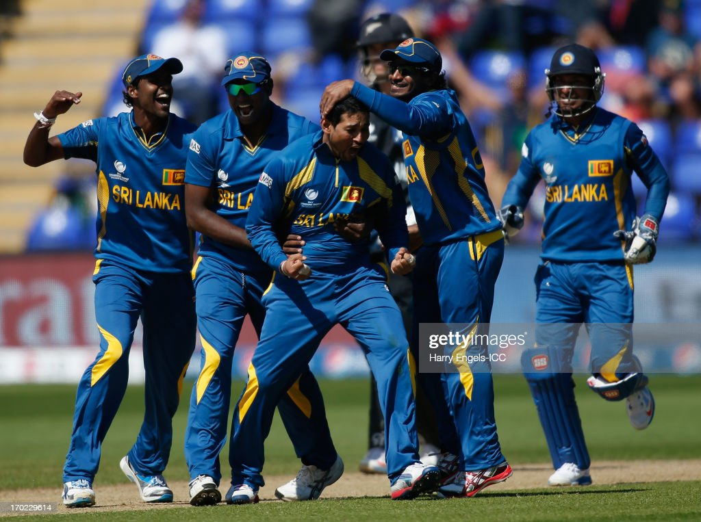 <a gi-track='captionPersonalityLinkClicked' href=/galleries/search?phrase=Tillakaratne+Dilshan&family=editorial&specificpeople=239186 ng-click='$event.stopPropagation()'>Tillakaratne Dilshan</a> of Sri Lanka (C) celebrates with teammates after dismissing James Franklin of New Zealand (not pictured) during the ICC Champions Trophy group A match between Sri Lanka and New Zealand at Cardiff Stadium on June 9, 2013 in Cardiff, Wales.
