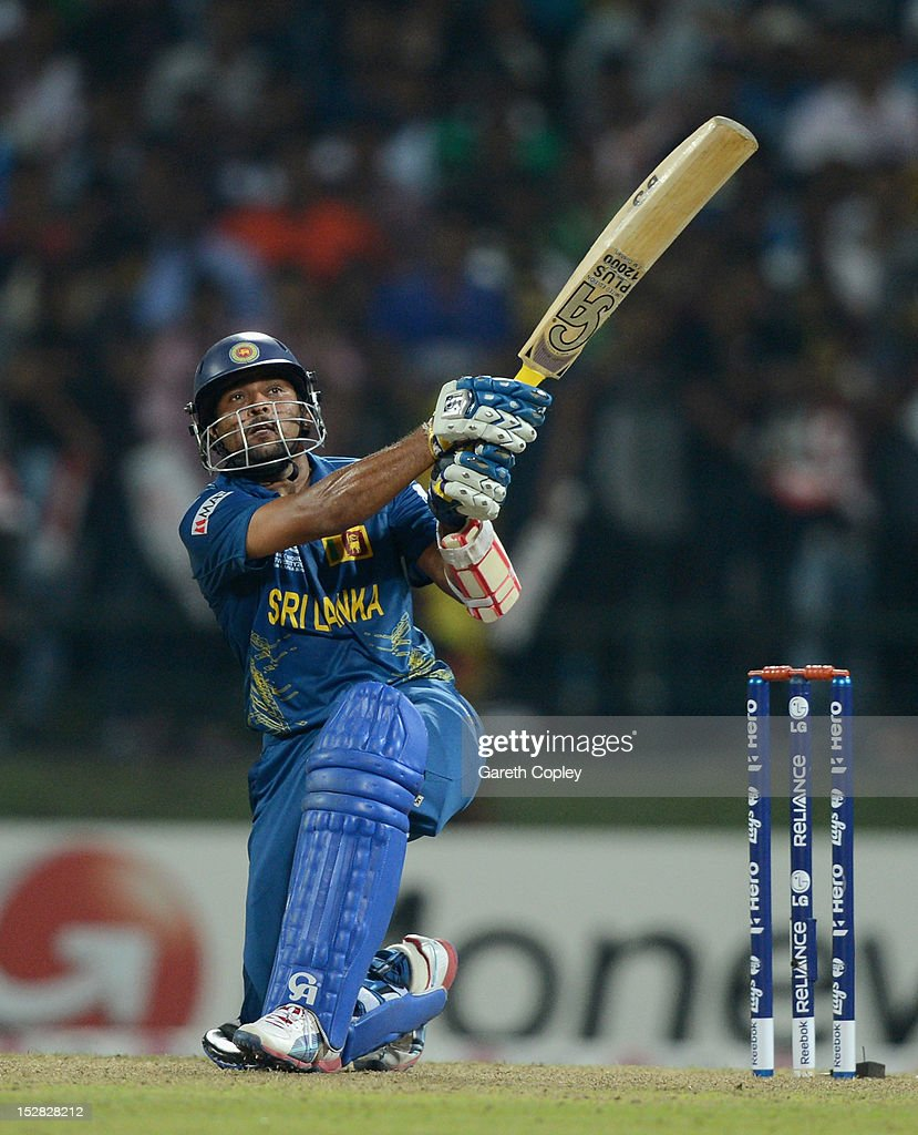<a gi-track='captionPersonalityLinkClicked' href=/galleries/search?phrase=Tillakaratne+Dilshan&family=editorial&specificpeople=239186 ng-click='$event.stopPropagation()'>Tillakaratne Dilshan</a> of Sri Lanka hits out for six runs during the ICC World Twenty20 2012 Super Eights Group 1 match between Sri Lanka and New Zealand at Pallekele Cricket Stadium on September 27, 2012 in Kandy, Sri Lanka.