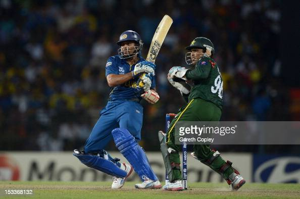 Tillakaratne Dilshan of Sri Lanka hits past Pakistan wicketkeeper Kamran Akmal during the ICC World Twenty20 2012 Semi Final between Sri Lanka and...