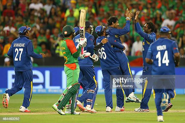 Tillakaratne Dilshan of Sri Lanka is congratulated by team mates after taking the wicket of Shakib Al Hasan of Bangladesh during the 2015 ICC Cricket...