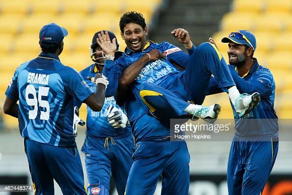 Tillakaratne Dilshan of Sri Lanka is congratulated by teammates Shaminda Eranga and Lahiru Thirimanne after taking the wicket of Kane Williamson of...
