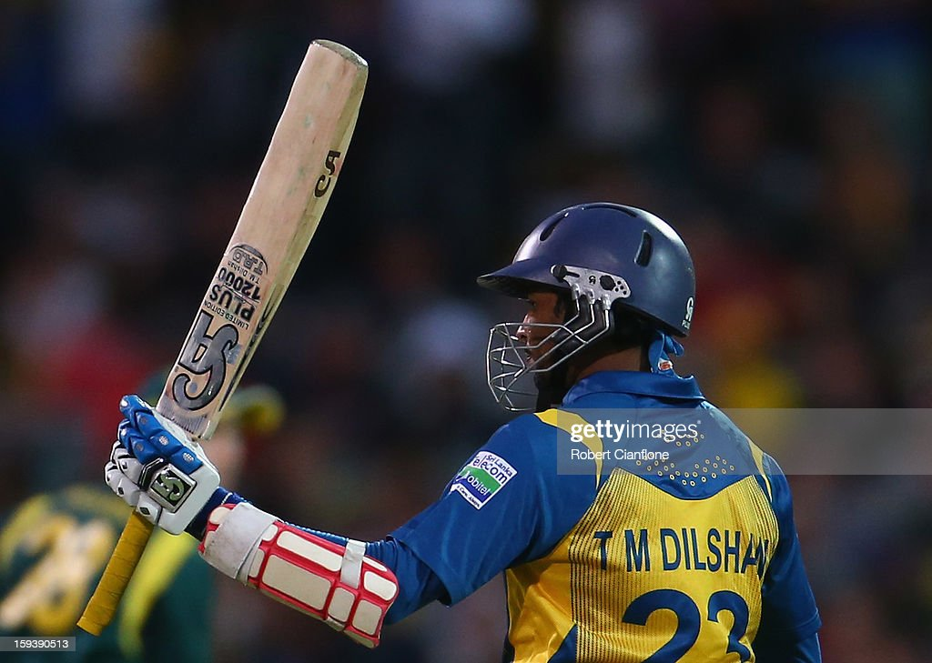 Tillakaratne Dilshan of Sri Lanka raises his bat after scoring his half century during game two of the Commonwealth Bank One Day International series between Australia and Sri Lanka at Adelaide Oval on January 13, 2013 in Adelaide, Australia.