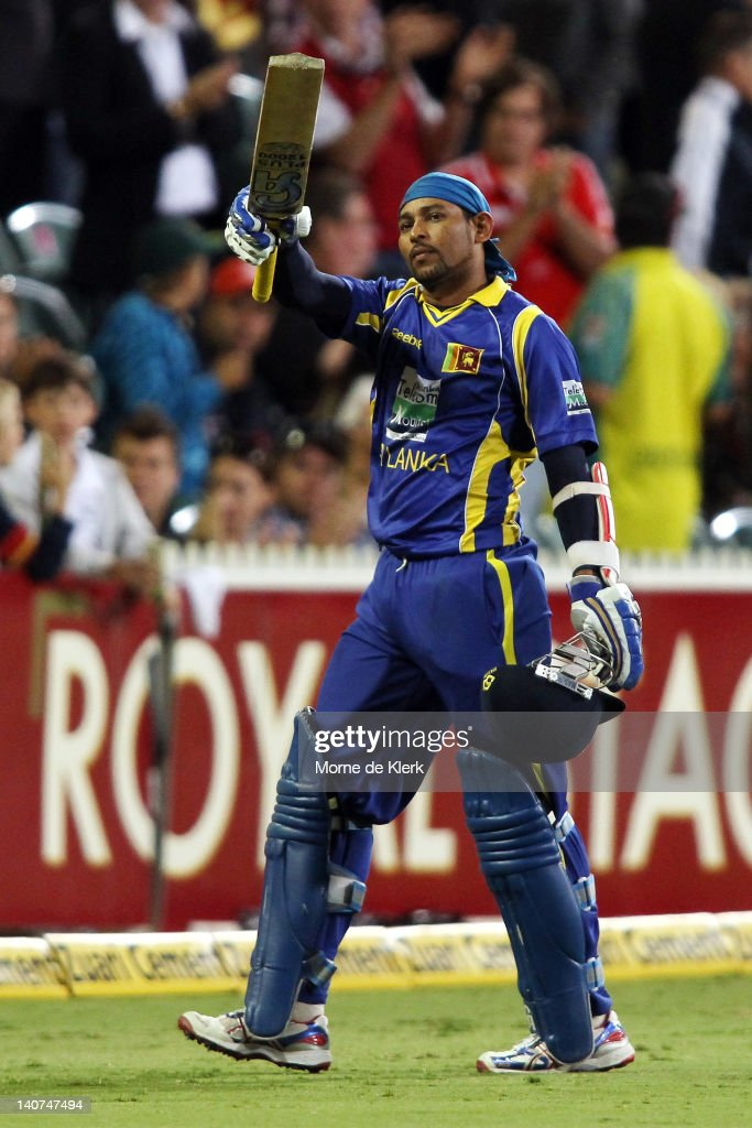 <a gi-track='captionPersonalityLinkClicked' href=/galleries/search?phrase=Tillakaratne+Dilshan&family=editorial&specificpeople=239186 ng-click='$event.stopPropagation()'>Tillakaratne Dilshan</a> of Sri Lanka raises his bat as he leaves the field after getting out during the second One Day International Final series match between Australia and Sri Lanka at Adelaide Oval on March 6, 2012 in Adelaide, Australia.