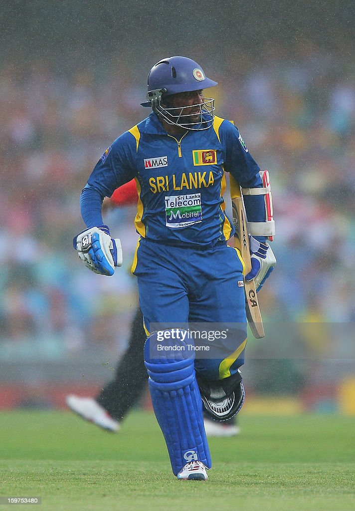 Tillakaratne Dilshan of Sri Lanka runs from the field as rain falls during game four of the Commonwealth Bank one day international series between Australia and Sri Lanka at Sydney Cricket Ground on January 20, 2013 in Sydney, Australia.