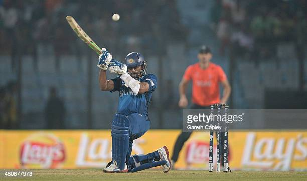 Tillakaratne Dilshan of Sri Lanka scoops the ball during the ICC World Twenty20 Bangladesh 2014 Group 1 match between England and Sri Lanka at Zahur...