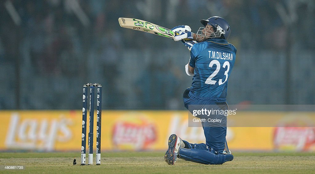 <a gi-track='captionPersonalityLinkClicked' href=/galleries/search?phrase=Tillakaratne+Dilshan&family=editorial&specificpeople=239186 ng-click='$event.stopPropagation()'>Tillakaratne Dilshan</a> of Sri Lanka scoops the ball for six runs during the ICC World Twenty20 Bangladesh 2014 Group 1 match between England and Sri Lanka at Zahur Ahmed Chowdhury Stadium on March 27, 2014 in Chittagong, Bangladesh.