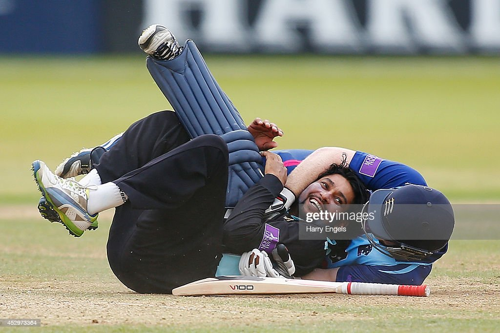<a gi-track='captionPersonalityLinkClicked' href=/galleries/search?phrase=Tillakaratne+Dilshan&family=editorial&specificpeople=239186 ng-click='$event.stopPropagation()'>Tillakaratne Dilshan</a> of Surrey laughs after he collided with <a gi-track='captionPersonalityLinkClicked' href=/galleries/search?phrase=Eoin+Morgan&family=editorial&specificpeople=689581 ng-click='$event.stopPropagation()'>Eoin Morgan</a> of Middlesex during the Royal London One-Day Cup match between Middlesex Panthers and Surrey at Lord's Cricket Ground on July 31, 2014 in London, England.