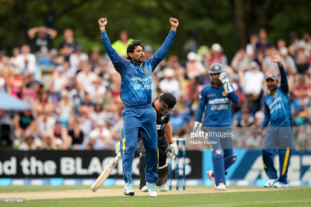Tillekaratne Dilshan of Sri Lanka celebrates the wicket of <a gi-track='captionPersonalityLinkClicked' href=/galleries/search?phrase=Corey+Anderson+-+Cricket+Player&family=editorial&specificpeople=12457249 ng-click='$event.stopPropagation()'>Corey Anderson</a> of New Zealand during the One Day International match between New Zealand and Sri Lanka at Hagley Oval on January 11, 2015 in Christchurch, New Zealand.