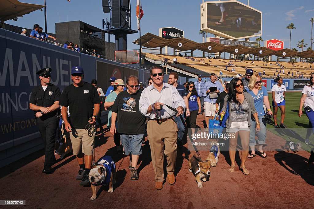 Tillman the Skateboarding Dog and former Los Angeles Dodgers great <a gi-track='captionPersonalityLinkClicked' href=/galleries/search?phrase=Steve+Garvey&family=editorial&specificpeople=210829 ng-click='$event.stopPropagation()'>Steve Garvey</a> walk the field the 'Bark In The Park' event for Dodgers fans and their dogs at Dodger Stadium on May 11, 2013 in Los Angeles, California.