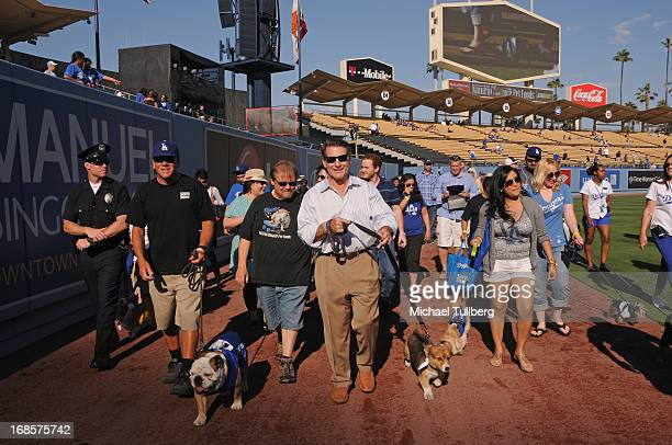 Tillman the Skateboarding Dog and former Los Angeles Dodgers great Steve Garvey walk the field the 'Bark In The Park' event for Dodgers fans and...