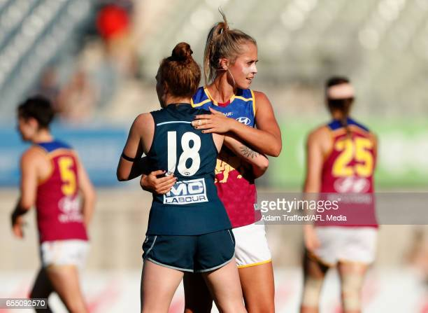 Tilly LucasRodd of the Blues hugs Kaitlyn Ashmore of the Lions during the 2017 AFLW Round 07 match between the Carlton Blues and the Brisbane Lions...