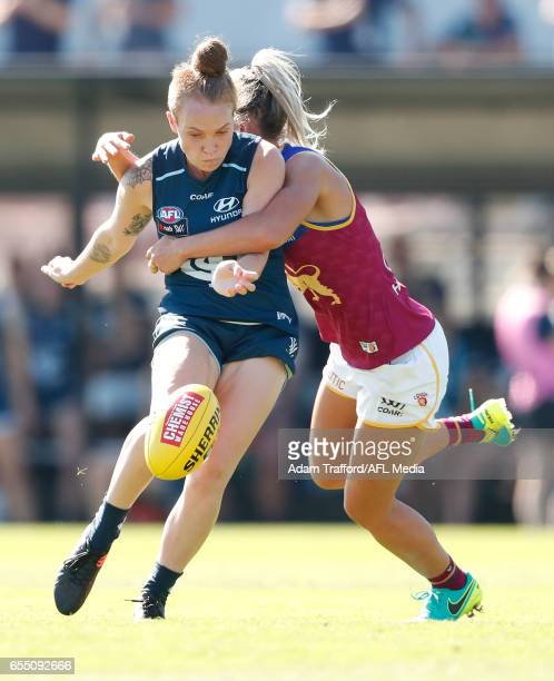 Tilly LucasRodd of the Blues is tackled by Kaitlyn Ashmore of the Lions during the 2017 AFLW Round 07 match between the Carlton Blues and the...