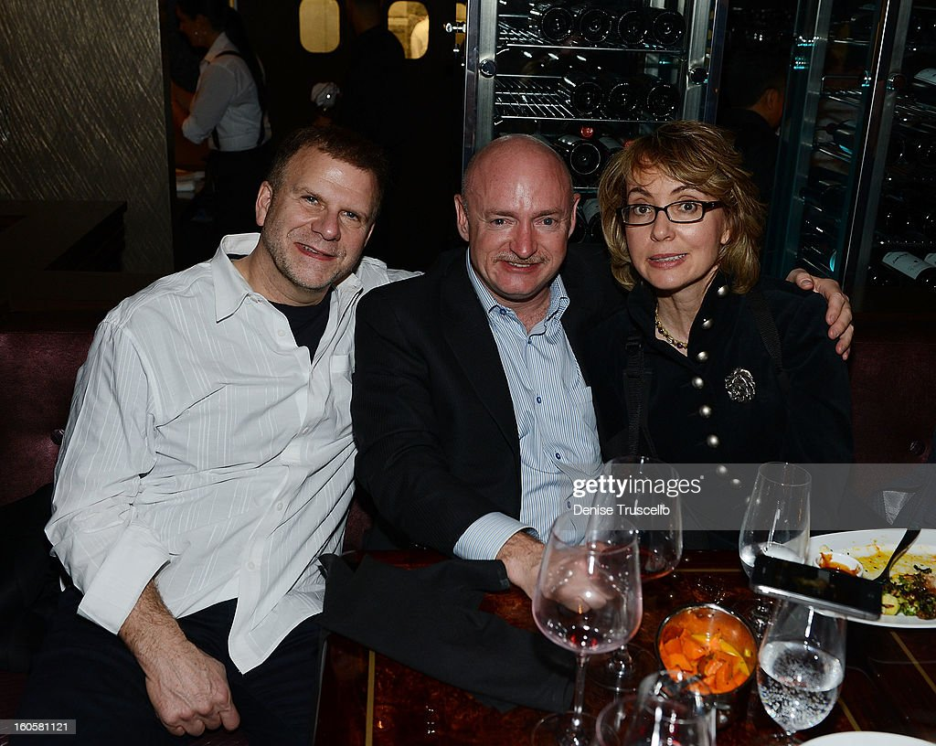 Tilman Fertitta, Mark Kelly and Gabrielle Giffords attend the grand opening of SHe by Morton's at Crystals at CityCenter on February 2, 2013 in Las Vegas, Nevada.