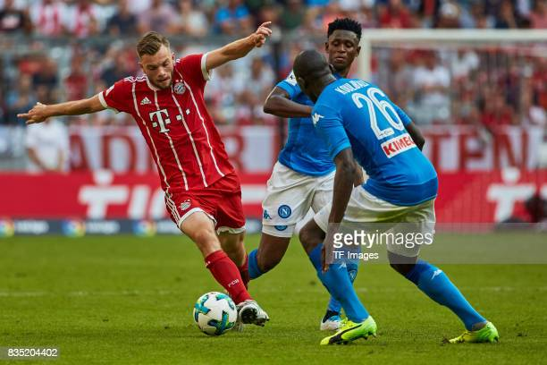 Tilmann Timothy of Bayern Muenchen and Amadou Diawara of Napoli and Kalidou Koulibaly of Napoli battle for the ball during the Audi Cup 2017 match...