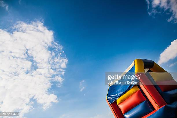 Tilt Image Of Bouncy Castle Against Sky
